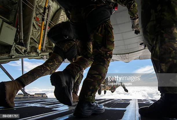 romanian paratroopers perform a halo jump out of a c-130j super hercules. - military training stock pictures, royalty-free photos & images