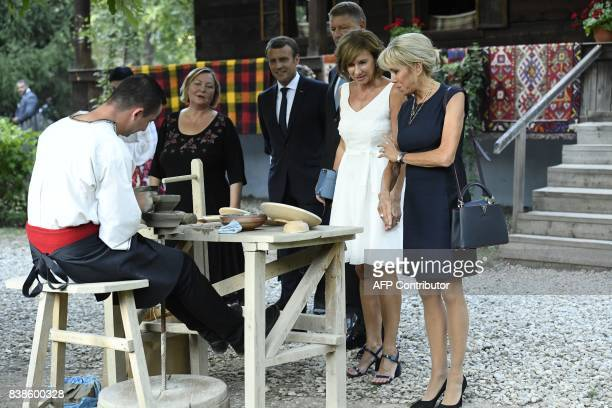 Romanian President Klaus Iohannis and French President Emmanuel Macron visit the Dimitrie Gusti National Village Museum with their wives Brigitte...