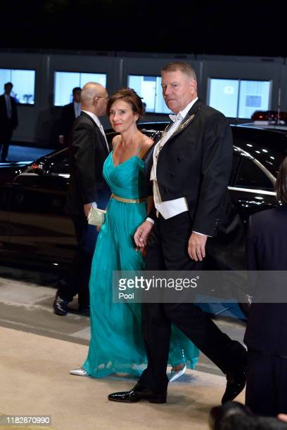 Romanian President Klaus Iohannis and his wife Carmen liohannis arrive to attend the Court Banquet at the Imperial Palace on October 22 2019 in Tokyo...
