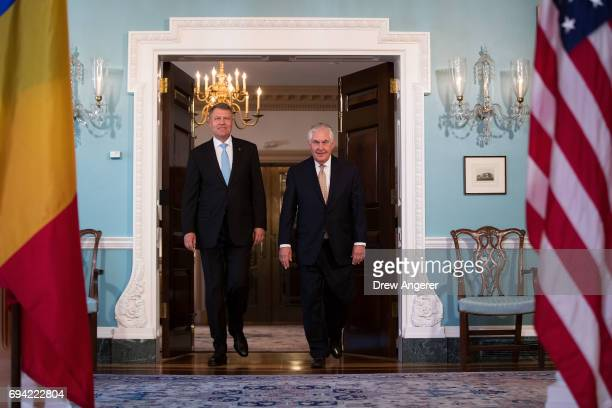Romanian President Klaus Iohannis and US Secretary of State Rex Tillerson arrive for a photo opportunity at the State Department June 9 2017 in...