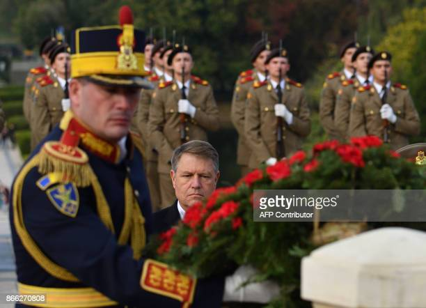 Romanian President Klaus Iohannis lays a wreath of flowers during the celebration of the Romanian Army Force's Day at the Monument of Unknown Soldier...