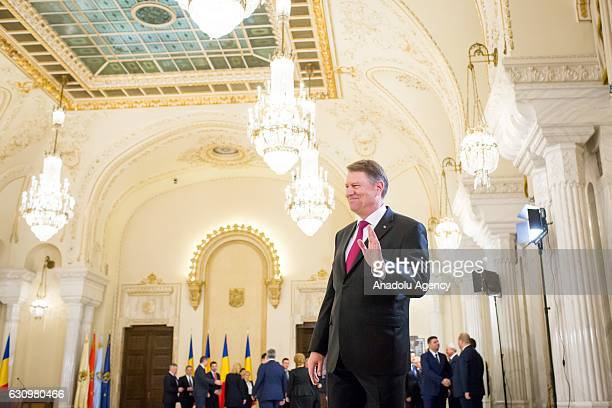Romanian President Klaus Iohannis talks to the media at the end of the swearing in ceremony of the new Romanian government in Bucharest Romania on...