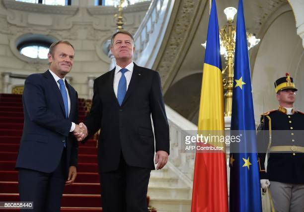Romanian President Klaus Iohannis welcomes President of the European Council Donald Tusk at the Cotroceni Palace in Bucharest on October 13 2017 /...