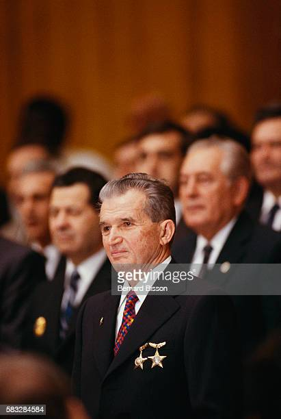 Romanian President Nicolae Ceausescu stands with party members during the Romanian Communist Party's 14th convention in Bucharest on November 20 1989