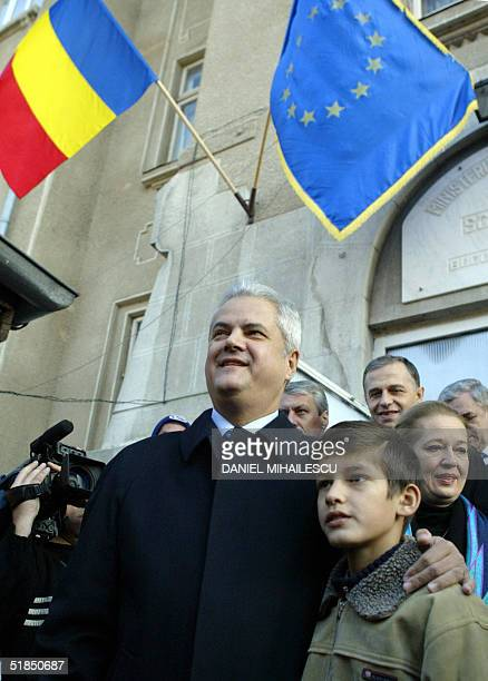 Romanian Prime Minister Adrian Nastase the presidential candidate on behalf of PSDPUR alliance holds his youngest son Mihnea at the exit from a...