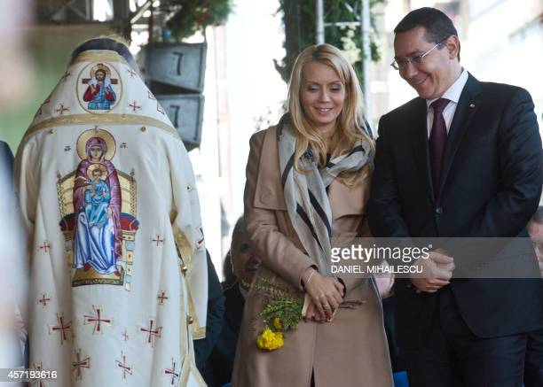 Romanian Prime Minister and candidate for presidential election Victor Ponta and his wife Daciana Sarbu attend a religious service on St...