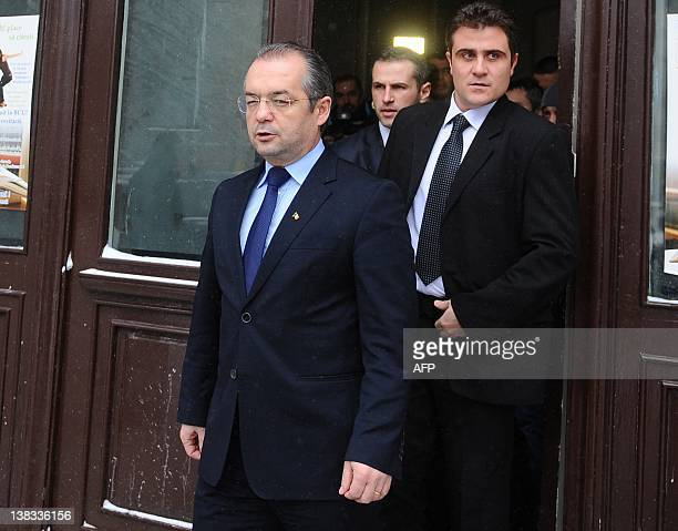 Romanian Prime Minister Emil Boc leaves the headquarters of the ruling Democrat Liberal Party in Bucharest on February 6 2012 Boc resigned on January...