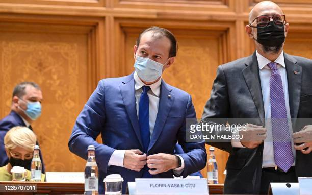Romanian Prime Minister Florin Citu prepares to address the Romanian Parliament during a non-confidence vote session at the Palace of Parliament in...