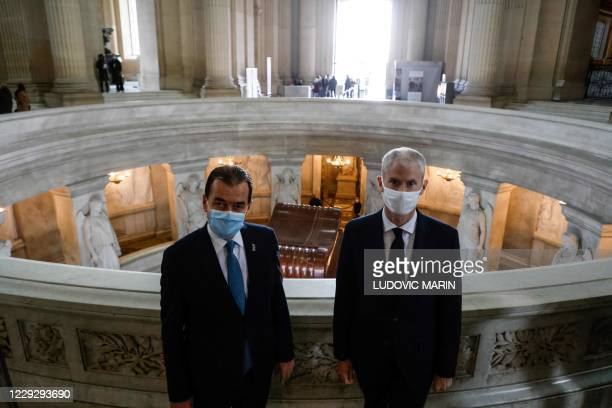 Romanian Prime Minister Ludovic Orban and French Junior Minister of Foreign Trade Franck Riester pose at the Tomb of Napoleon in the Invalides in...