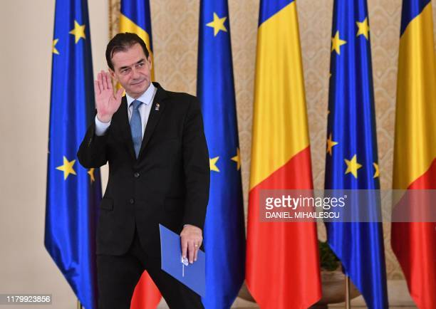 Romanian Prime Minister Ludovic Orban waves during the swearingin ceremony at the Cotroceni Presidential Palace in Bucharest on November 4 2019...
