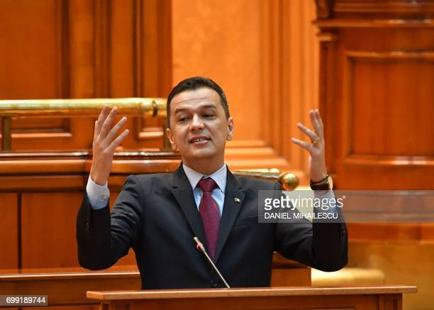 Romanian Prime Minister Sorin Grindeanu addresses the Romanian Parliament during a noconfidence vote in Bucharest on June 21 2017 Romania's leftwing...