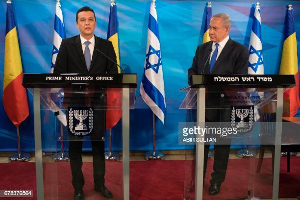 Romanian Prime Minister Sorin Grindeanu and Israeli Prime Minister Benjamin Netanyahu give a joint press conference at the Prime Minister's Office in...