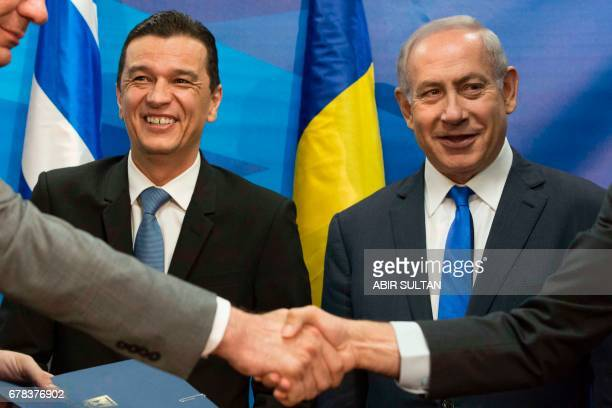 Romanian Prime Minister Sorin Grindeanu and Israeli Prime Minister Benjamin Netanyahu smile during a joint press conference at the Prime Minister's...