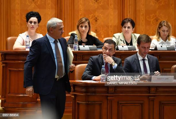Romanian Prime Minister Sorin Grindeanu looks at Liviu Dragnea the president of the ruling Social Democrat party as he prepares to adress the...