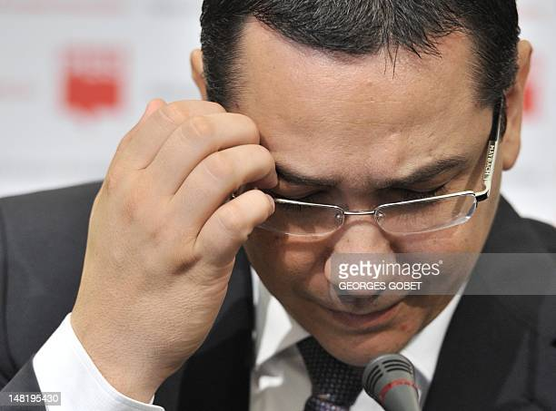 Romanian Prime Minister Victor Ponta gestures during a press conference at the Residence Palace near the European Union Headquarters in Brussels on...