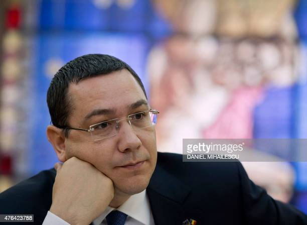 Romanian Prime Minister Victor Ponta is pictured during an interview with journalists at the Romanian Government headquarters in Bucharest on June 9...