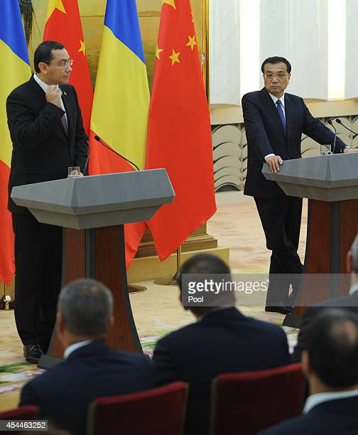 Romanian Prime Minister Victor Ponta talks during a joint press conference with Chinese Premier Li Keqiang at the Great Hall of the People on...