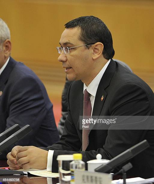 Romanian Prime Minister Victor Ponta talks with Chinese Premier Li Keqiang during a meeting at the Great Hall of the People on September 1 2014 in...