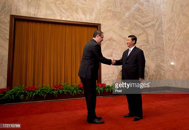Romanian Prime Minister VictorViorel Ponta is greeted by Chinese President Xi Jinping upon arrival for a meeting at the Great Hall of the People on...