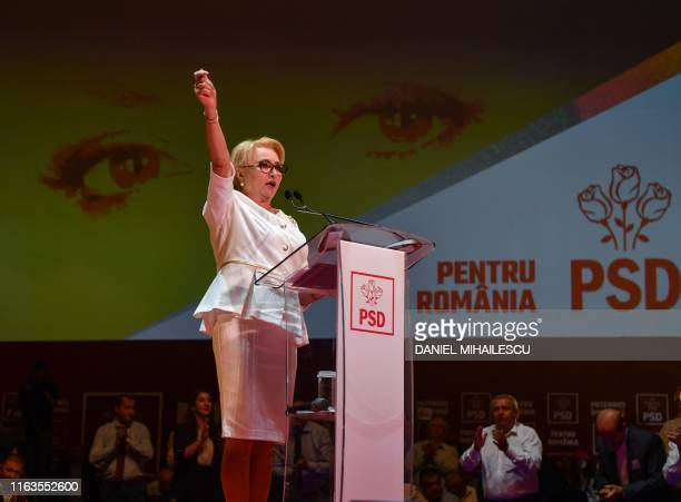 Romanian Prime Minister Viorica Dancila addresses delegates during an extraordinary congress of her ruling Social Democratic party at the Parliament...