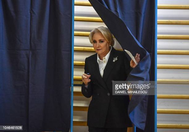 Romanian Prime Minister Viorica Dancila leaves a polling booth as she prepares to cast her ballot in a referendum to change the constitutional...
