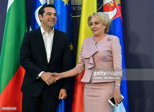 Romanian Prime Minister Viorica Dancila shakes hands with Greek Prime Minister Alexis Tsipras as he arrives at the Victoria Palace the Romanian...