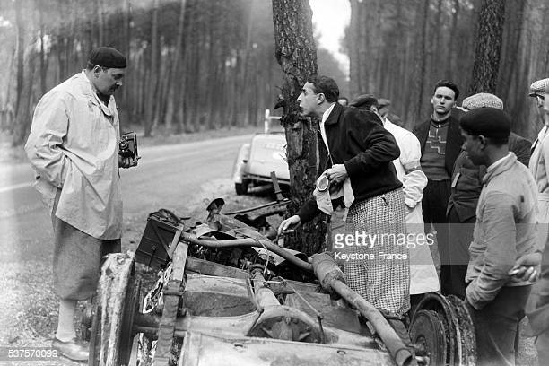 Romanian Prince Nicolas examines the debris of the car of Mrs Siko competitor in the 24 Hours of Le Mans race unscathed from an accident that...