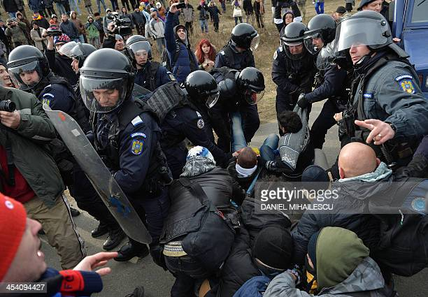 Romanian protesters scuffle with Romanian gendarmes after breaking the fence of the exploring perimeter of US energy giant Chevron in Pungesti...