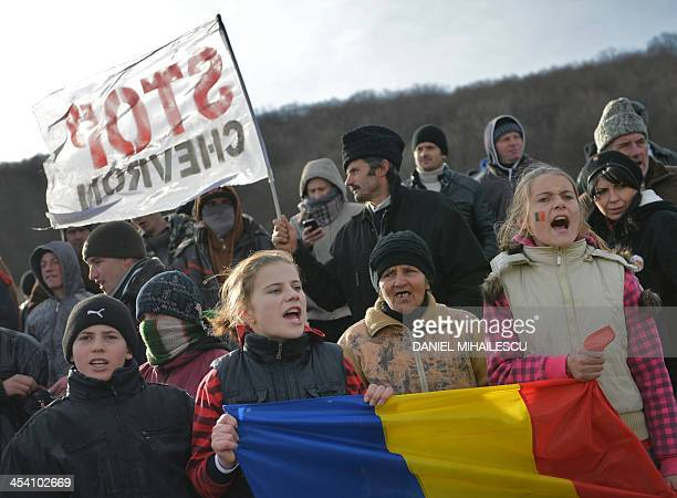 Romanian protesters shout at the entrance of the exploring perimeter of US energy giant Chevron in Pungesti Romania on December 7 2013 Around 500...