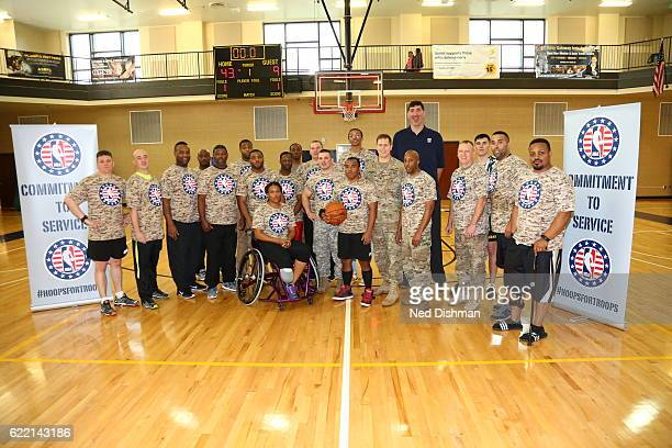 Romanian retired professional basketball player Gheorghe Muresan poses for a photo during an event for Wounded Warriors at Walter Reed Bethesda Naval...