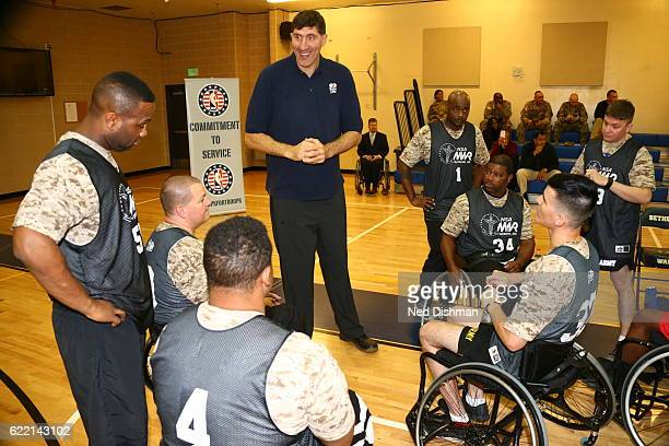 Romanian retired professional basketball player Gheorghe Muresan talks to participants during an event for Wounded Warriors at Walter Reed Bethesda...