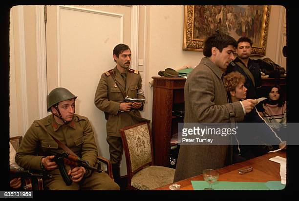Romanian revolutionaries occupy Nicolae Ceausescu's own office in December 1989 following his failed attempt to flee the country