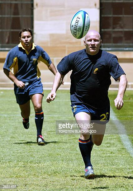 Romanian scrumhalfs Cristian Podea and Iulian Andrei chase the ball while training for the Rugby World Cup at the historic Victoria Barracks in...