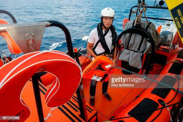 Romanian Search and Rescue member of SOSMediterranee NGO on board Dragos Nicolae poses with a life vest on a rescue rip of the Aquarius rescue vessel...