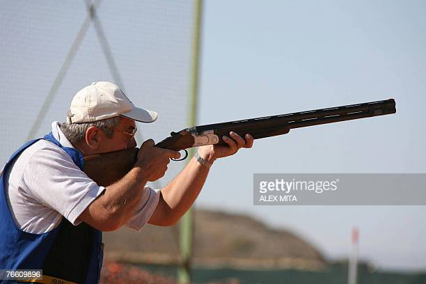 Romanian shooter Ioan Toman prepares to shoot during the men's skeet final of the ISSF World Shooting Championships in Nicosia 09 September 2007 AFP...