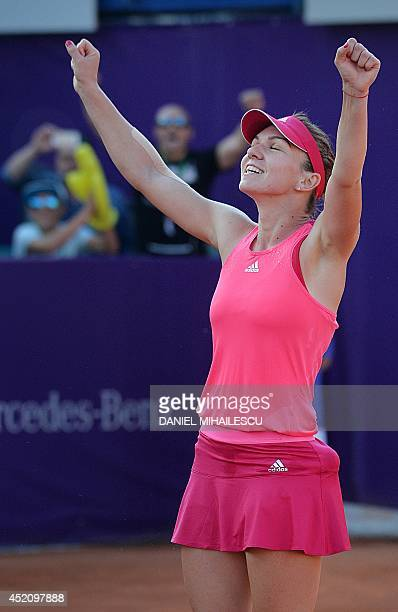 Romanian Simona Halep celebrates after winning the single final at the WTA Bucharest tennis tournament in Bucharest on July 13 2014 Halep won against...