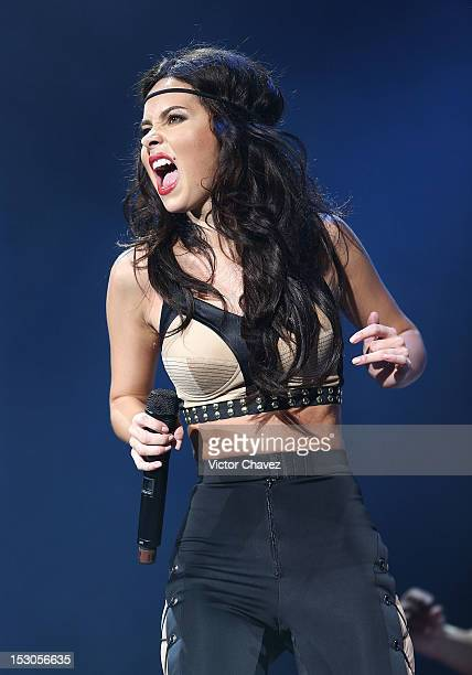 Romanian singer Inna performs onstage at Pepsi Center WTC on September 28 2012 in Mexico City Mexico