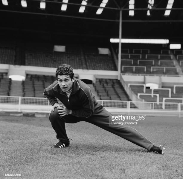 Romanian soccer player Mircea Lucescu doing a side lunge at Wembley Stadium in preparation of a match against England, London, UK, 15th January 1969.