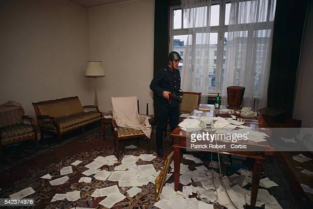 A Romanian soldier guarding a ransacked office in the House of the People days after the December 1989 uprising which marked the end of dictator...