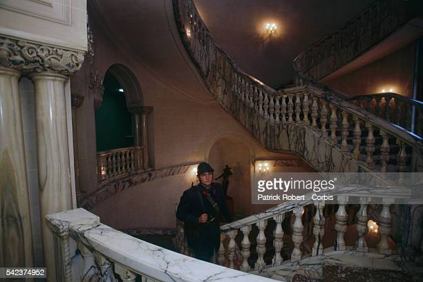 A Romanian soldier guarding a stairway in the House of the People days after the December 1989 uprising which marked the end of dictator Nicolae...