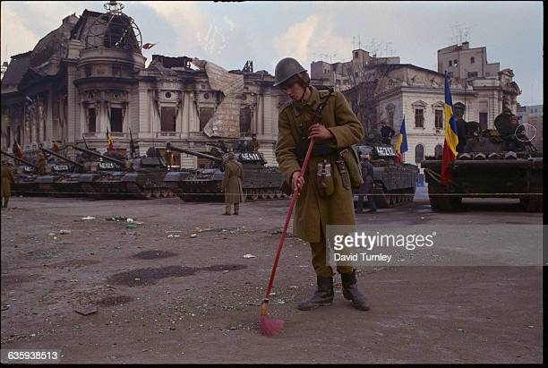 Romanian Soldier Sweeping the Ground
