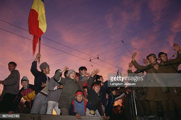Romanian soldiers greet demonstrators from the back of a truck during insurrection in Timisoara Romania on December 22 1989 Romanian citizens are...