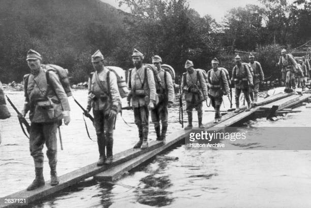 Romanian soldiers retreat across a river after the fall of Bucharest