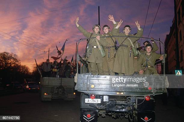 Romanian soldiers wave from the back of a truck during insurrection in Timisoara Romania on December 22 1989 Romanian citizens are rising up against...