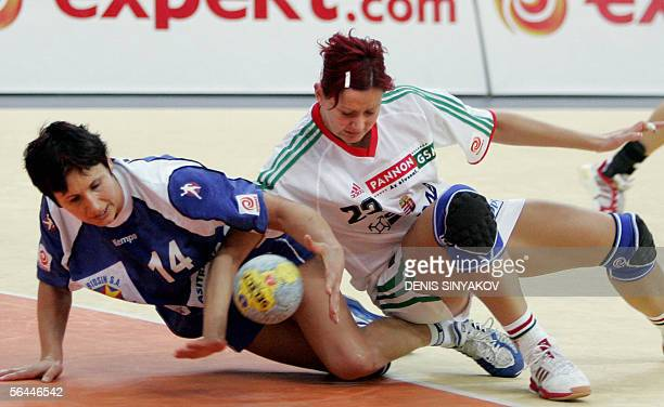 Romanian Steluta Luca fights for the ball with Hungary's Gabriella Szucs during their semifinals handball match of XVIIth Women's World Championships...