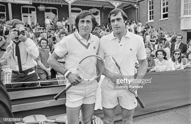 Romanian tennis player Ilie Nastase and British tennis player Roger Taylor reach the final of the Men's Singles at the Queen's Club Championships in...
