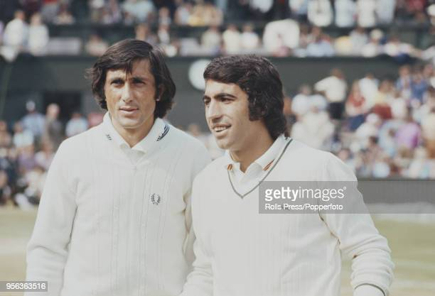 Romanian tennis player Ilie Nastase and Spanish tennis player Manuel Orantes pictured together prior to play in the semifinals of the Men's Singles...
