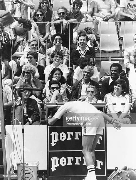 Romanian tennis player Ilie Nastase entertains the crowds by putting his head in a fridge during the French Open Tennis Championships at Roland...