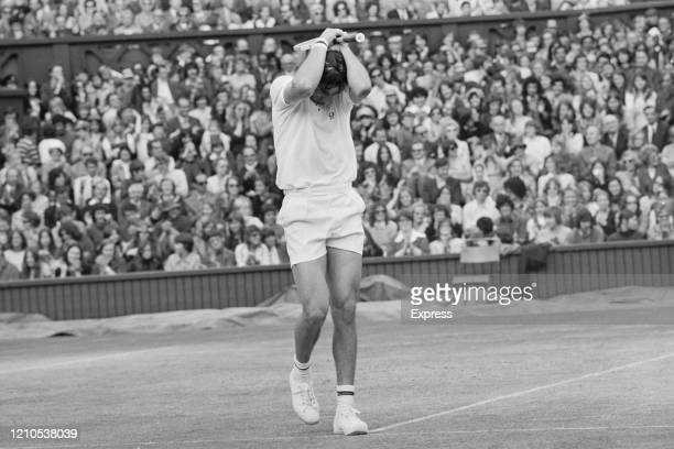 Romanian tennis player Ilie Nastase holds his head in despair during the Men's Singles Final against the United States' Stan Smith at the 1972...