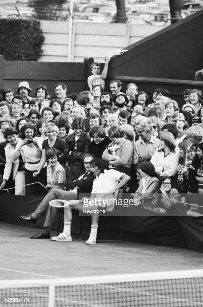 Romanian tennis player Ilie Nastase holds up his Wimbledon match against Rhodesia's Andrew Pattison for ten minutes so that referee Fred Hoyles can...